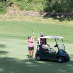Woman Retrieving Club from Bag